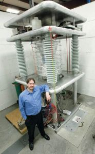 Greg Piefer with the neutron generator he invented