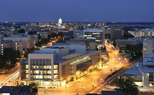 skyline of UW-Madison campus featuring the wisconsin Insittures for Discovery and Wisconsin State Capitol in the background