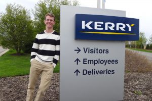 Chase Bruggeman poses outside of the Kerry building