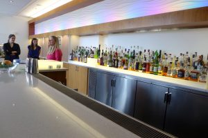 Long bar featuring different alcoholic bottles