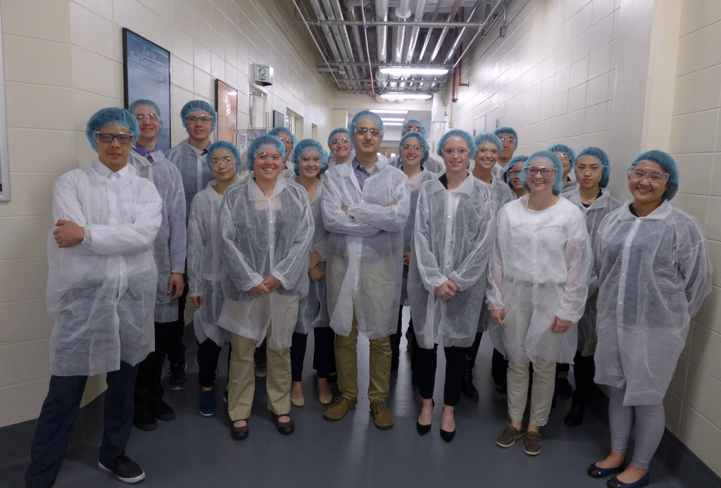 UW-Madison students pose in a hallway at Kerry Group after a tour of the facilities