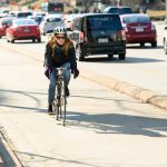 A cyclist riding in the bike lane on University Avenue in Madison